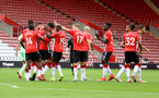 SOUTHAMPTON, ENGLAND - AUGUST 07: Southampton players celebrate with Tino Livramento after he assisted Theo Walcott for Southampton's goal during the pre season friendly match between Southampton FC and Athletic Club at St Mary's Stadium on August 07, 2021 in Southampton, England. (Photo by Matt Watson/Southampton FC via Getty Images)