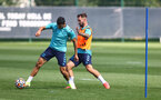 SOUTHAMPTON, ENGLAND - AUGUST 11: Adam Armstrong(R)) and Mohamed Elyounoussi during a Southampton FC training session at the Staplewood Campus on August 11, 2021 in Southampton, England. (Photo by Matt Watson/Southampton FC via Getty Images)