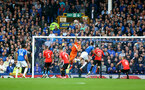 LIVERPOOL, ENGLAND - AUGUST 14: Alex McCarthy of Southampton punches the ball away during the Premier League match between Everton  and  Southampton at Goodison Park on August 14, 2021 in Liverpool, England. (Photo by Matt Watson/Southampton FC via Getty Images)