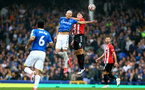LIVERPOOL, ENGLAND - AUGUST 14: Richarlison(L) of Everton and Oriol Romeu(R) of Southampton during the Premier League match between Everton  and  Southampton at Goodison Park on August 14, 2021 in Liverpool, England. (Photo by Matt Watson/Southampton FC via Getty Images)