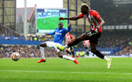 LIVERPOOL, ENGLAND - AUGUST 14: Abdoulaye Doucoure(L) of Everton and Moussa Djenepo(R) of Southampton during the Premier League match between Everton  and  Southampton at Goodison Park on August 14, 2021 in Liverpool, England. (Photo by Matt Watson/Southampton FC via Getty Images)