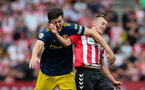 SOUTHAMPTON, ENGLAND - AUGUST 22: Harry Maguire  and James Ward-Prowse during the Premier League match between Southampton and Manchester United at St Mary's Stadium on August 22, 2021 in Southampton, England. (Photo by Chris Moorhouse/Southampton FC via Getty Images)