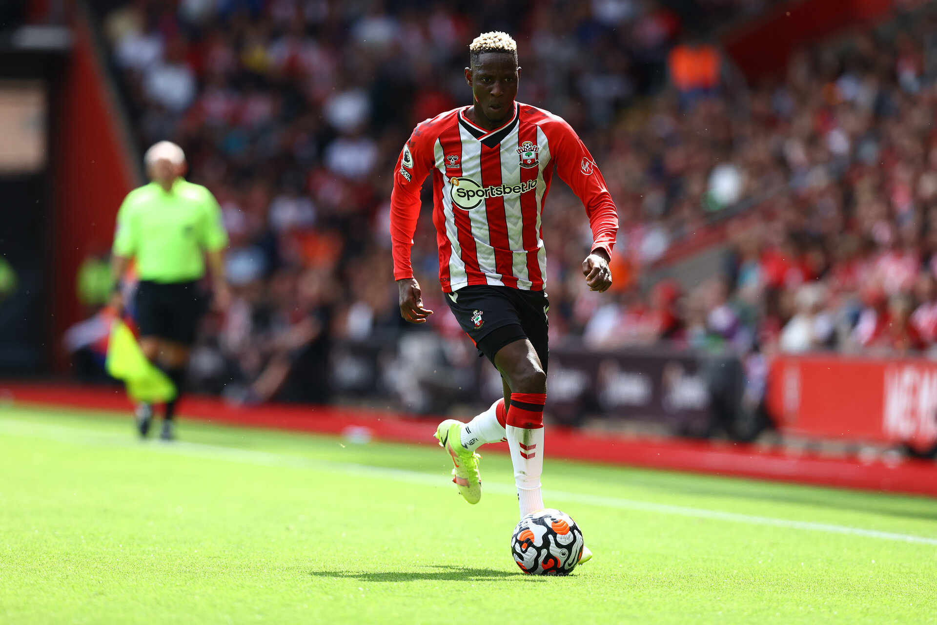 SOUTHAMPTON, ENGLAND - AUGUST 22: Moussa Djenepo of Southampton during the Premier League match between Southampton  and  Manchester United at St Mary's Stadium on August 22, 2021 in Southampton, England. (Photo by Matt Watson/Southampton FC via Getty Images)