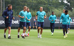 SOUTHAMPTON, ENGLAND - SEPTEMBER 16:Head of Sports Science Alek Gross(L) leads players on a warm up with James Ward-Prowse(L) and Oriol Romeu during a Southampton FC training session at the Staplewood Campus on September 16, 2021 in Southampton, England. (Photo by Matt Watson/Southampton FC via Getty Images)