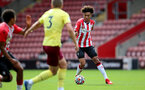SOUTHAMPTON, ENGLAND - SEPTEMBER 19: Kamari Doyle(R) of Southampton during the Premier League 2 match between Southampton B Team and Burnley at St Mary's Stadium on September 19, 2021 in Southampton, England. (Photo by Isabelle Field/Southampton FC via Getty Images)