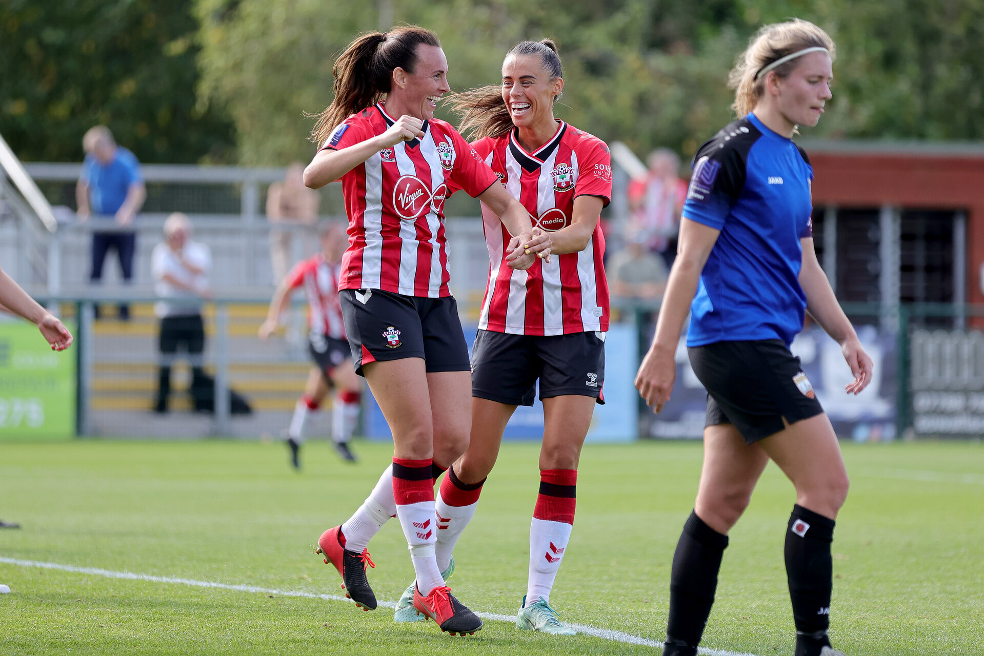 CHELTENHAM, ENGLAND - SEPTEMBER 26: Leeta Rutherford(L) of celebrates scoring with Laura Rafferty(R) of Southampton during the FA National League Southern Premier match between   Southampton Women and London Bees at The Snows Stadium on September 26, 2021 in  Cheltenham, England. (Photo by Isabelle Field/Southampton FC via Getty Images)