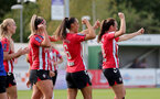 CHELTENHAM, ENGLAND - SEPTEMBER 26: Ciara Watling(L) and  Laura Rafferty celebrate after Leeta Rutherford(R) of Southampton scores during the FA National League Southern Premier match between   Southampton Women and London Bees at The Snows Stadium on September 26, 2021 in  Cheltenham, England. (Photo by Isabelle Field/Southampton FC via Getty Images)
