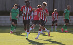 SOUTHAMPTON, ENGLAND - OCTOBER 01: Dominic Ballard of Southampton celebrates with Kazeem Olaigbe of Southampton after he scores a penalty during the Premier League 2 match between Southampton B Team and Stoke City at Staplewood Training Ground on October 01, 2021 in Southampton, England. (Photo by Isabelle Field/Southampton FC via Getty Images)