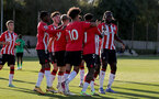 SOUTHAMPTON, ENGLAND - OCTOBER 01: Southampton players celebrate with Kazeem Olaigbe after he scores a penalty during the Premier League 2 match between Southampton B Team and Stoke City at Staplewood Training Ground on October 01, 2021 in Southampton, England. (Photo by Isabelle Field/Southampton FC via Getty Images)